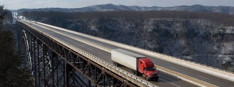 Semi Truck Driving Over Bridge